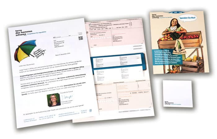 Kuvertiertes Mailing mit personalisierten Adressetiketten sowie Einzahlungsscheinen und Give Away